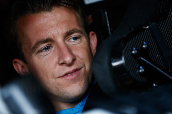 WATKINS GLEN, NY - AUGUST 08:  AJ Allmendinger, driver of the #47 Scott Products Chevrolet, sits in his car in the garage area during practice for the NASCAR Sprint Cup Series Cheez-It 355 at Watkins Glen International on August 8, 2014 in Watkins Glen, New York.  (Photo by Jeff Zelevansky/Getty Images)