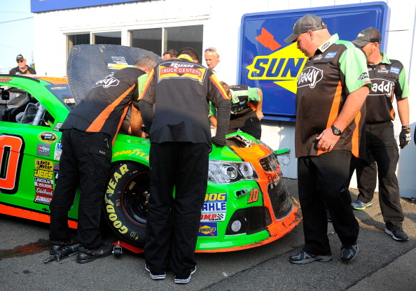 WATKINS GLEN, NY - AUGUST 08:  Crew members inspect the the #10 GoDaddy Chevrolet, driven by Danica Patrick, after an on-track incident during practice for the NASCAR Sprint Cup Series Cheez-It 355 at Watkins Glen International on August 8, 2014 in Watkins Glen, New York.  (Photo by Jared C. Tilton/Getty Images)
