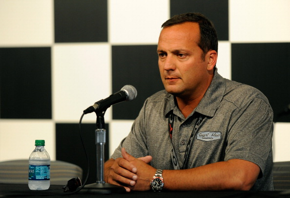WATKINS GLEN, NY - AUGUST 10:  Greg Zipadelli, Stewart-Haas Racing vice president of competition, at a press conference prior to the NASCAR Sprint Cup Series Cheez-It 355 at Watkins Glen International on August 10, 2014 in Watkins Glen, New York. Zipadelli announced that driver Tony Stewart will not drive in the Cheez-It 355 At The Glen race. Stewart hit and killed sprint car driver Kevin Ward Jr. during a dirt track race August 9, after Ward Jr. had exited his car.