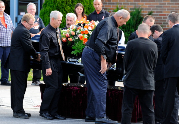 TURIN, NY - AUGUST 14:  Pallbearers help to carry the casket of sprint car driver Kevin Ward Jr. at South Lewis Senior High School on August 14, 2014 in Turin, New York. Ward was killed August 9, when he exited his car during a dirt track race and was struck by a car driven by NASCAR driver Tony Stewart.  (Photo by Rich Barnes/Getty Images)