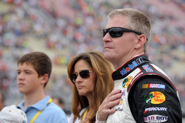 BROOKLYN, MI - AUGUST 17:  Jeff Burton, driver of the #14 Mobil 1/Bass Pro Shops Chevrolet, stands on the grid prior to the NASCAR Sprint Cup Series Pure Michigan 400 at Michigan International Speedway on August 17, 2014 in Brooklyn, Michigan.  (Photo by Robert Reiners/Getty Images)