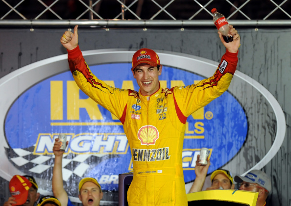 Joey Logano celebrates after winning the NASCAR Sprint Cup Series Irwin Tools Night Race at Bristol Motor Speedway on August 23, 2014 in Bristol, Tennessee. (Getty Images)