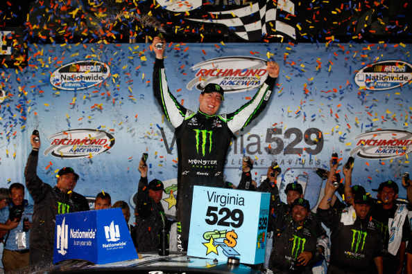 Kyle Busch celebrates his win in the NASCAR Nationwide Series Virginia529 College Savings 250 at Richmond International Raceway on September 5, 2014 in Richmond, Virginia. (Getty Images)