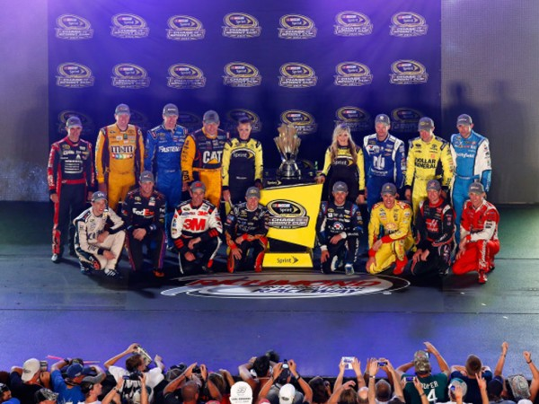 RICHMOND, VA - SEPTEMBER 06:  (Back Row L - R) Jeff Gordon, driver of the #24 Drive to End Hunger Chevrolet, Kyle Busch, driver of the #18 M&M's Toyota, Carl Edwards, driver of the #99 Kelloggs/Frosted Flakes Ford, Ryan Newman, driver of the #31 Catepillar Chevrolet, Miss Sprint Cup Madison Martin, Miss Sprint Cup Kim Coon, Dale Earnhardt Jr., driver of the #88 Nationwide Insurance Chevrolet, Matt Kenseth, driver of the #20 Dollar General Toyota, Aric Almirola, driver of the #43 Gwaltney Ford, (Front Row L- R) Brad Keselowski, driver of the #2 Miller Lite Ford, Denny Hamlin, driver of the #11 FedEx Express Toyota, Greg Biffle, driver of the #16 3M Call Before You Dig Ford, AJ Allmendinger, driver of the #47 Bush's Beans Chevrolet, Kasey Kahne, driver of the #5 Farmers Insurance Chevrolet, Joey Logano, driver of the #22 Shell-Pennzoil Ford, Kurt Busch, driver of the #41 Haas Automation Chevrolet, and Kevin Harvick, driver of the #4 Budweiser Chevrolet, pose with the Sprint Cup Trophy after qualifying for the Chase for the Sprint Cup during the NASCAR Sprint Cup Series Federated Auto Parts 400 at Richmond International Raceway on September 6, 2014 in Richmond, Virginia.  (Photo by Jared Wickerham/Getty Images)
