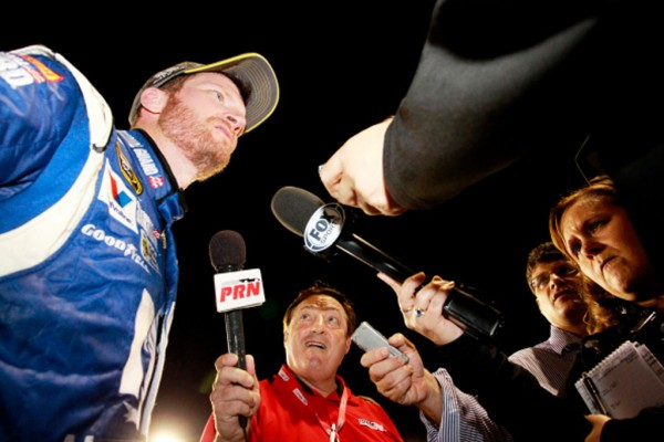 RICHMOND, VA - SEPTEMBER 06:  Dale Earnhardt Jr., driver of the #88 Nationwide Insurance Chevrolet, speaks with the media on pit road after qualifying for the Chase For The Sprint Cup following the NASCAR Sprint Cup Series Federated Auto Parts 400 at Richmond International Raceway on September 6, 2014 in Richmond, Virginia.  (Photo by Brian Lawdermilk/Getty Images)