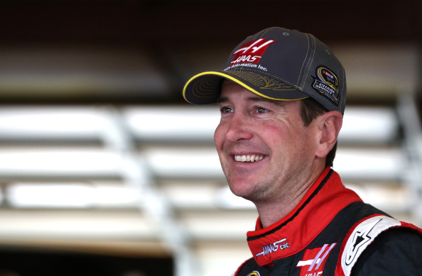 JOLIET, IL - SEPTEMBER 12: Kurt Busch, driver of the #41 Haas Automation Chevrolet, stands in the garage area during practice for the NASCAR Nationwide Series Jimmy John's Freaky Fast 300 Powered by Coca-Cola at Chicagoland Speedway on September 12, 2014 in Joliet, Illinois.  (Photo by Sarah Glenn/Getty Images)