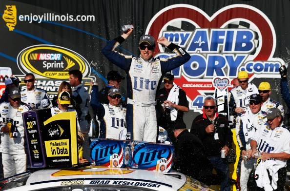 JOLIET, IL - SEPTEMBER 14:  Brad Keselowski, driver of the #2 Miller Lite Ford, celebrates in victory lane after winning the NASCAR Sprint Cup Series MyAFibStory.com 400 at Chicagoland Speedway on September 14, 2014 in Joliet, Illinois.  (Photo by Sean Gardner/Getty Images)