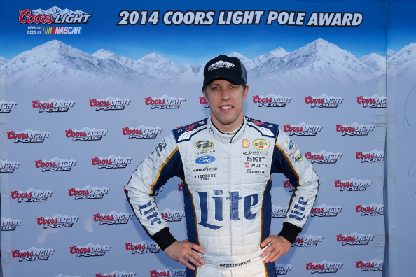 LOUDON, NH - SEPTEMBER 19:  Brad Keselowski, driver of the #2 Miller Lite Ford, celebrate setting the pole position during qualifying for the NASCAR Sprint Cup Series Sylvania 300 at New Hampshire Motor Speedway on September 19, 2014 in Loudon, New Hampshire.  (Photo by Chris Trotman/Getty Images)