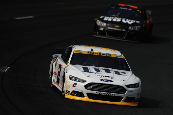 LOUDON, NH - SEPTEMBER 20:  Brad Keselowski, driver of the #2 Miller Lite Ford, leads Martin Truex Jr., driver of the #78 Furniture Row Chevrolet, during practice for the NASCAR Sprint Cup Series Sylvania 300 at New Hampshire Motor Speedway on September 20, 2014 in Loudon, New Hampshire.  (Photo by Will Schneekloth/Getty Images)