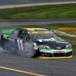 LOUDON, NH - SEPTEMBER 21:  Denny Hamlin, driver of the #11 FedEx Ground Toyota, drives with damage to his car after crashing during the NASCAR Sprint Cup Series Sylvania 300 at New Hampshire Motor Speedway on September 21, 2014 in Loudon, New Hampshire.  (Photo by Chris Trotman/Getty Images)
