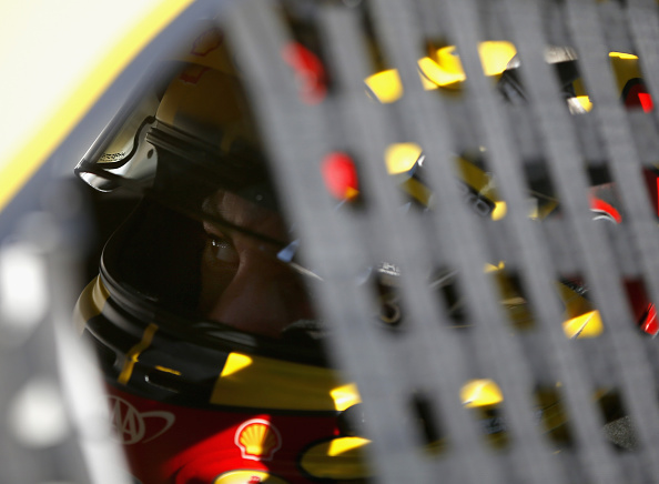 DOVER, DE - SEPTEMBER 26:  Joey Logano, driver of the #22 Shell Pennzoil Ford, stands on pit road during qualifying for the NASCAR Sprint Cup Series AAA 400 at Dover International Speedway on September 26, 2014 in Dover, Delaware.  (Photo by Matt Sullivan/Getty Images)