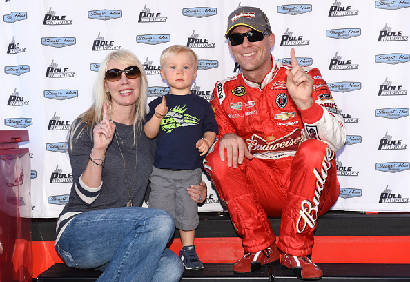 DOVER, DE - SEPTEMBER 26: Kevin Harvick, driver of the #4 Budweiser Chevrolet, poses with wife DeLana and son Keelan after qualifying on pole for the NASCAR Sprint Cup Series AAA 400 at Dover International Speedway on September 26, 2014 in Dover, Delaware.  (Photo by Patrick Smith/Getty Images)