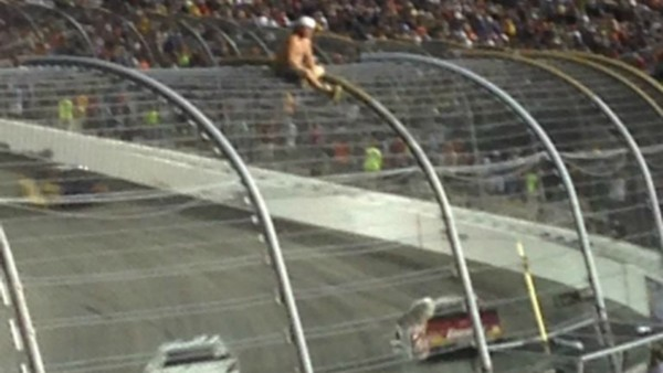 A fan is seen on the fence at Richmond International Raceway Saturday night.YouTube