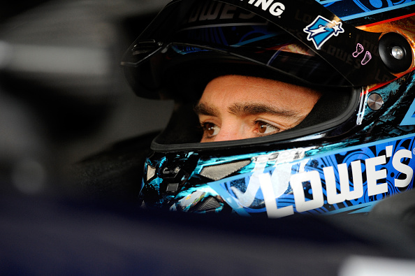 KANSAS CITY, KS - OCTOBER 04:  Jimmie Johnson, driver of the #48 Lowe's Chevrolet, sits in his car during practice for the NASCAR Sprint Cup Series Hollywood Casino 400 at Kansas Speedway on October 4, 2014 in Kansas City, Kansas.  (Photo by Jared C. Tilton/Getty Images)