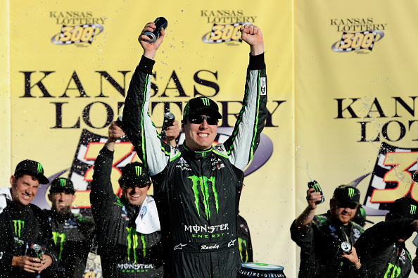 KANSAS CITY, KS - OCTOBER 04:  Kyle Busch, driver of the #54 Monster Energy Toyota, celebrates in victory lane after winning during the NASCAR Nationwide Series Kansas Lottery 300 at Kansas Speedway on October 4, 2014 in Kansas City, Kansas.  (Photo by Jared C. Tilton/Getty Images)