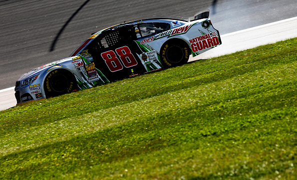 KANSAS CITY, KS - OCTOBER 05:  Dale Earnhardt Jr., driver of the #88 Diet Mountain Dew Chevrolet, drives with damage after crashing during the NASCAR Sprint Cup Series Hollywood Casino 400 at Kansas Speedway on October 5, 2014 in Kansas City, Kansas.  (Photo by Sean Gardner/Getty Images)