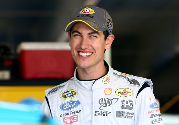 CHARLOTTE, NC - OCTOBER 09:  Joey Logano, driver of the #22 Pennzoil Platinum Ford, looks on in the garage during practice for the NASCAR Sprint Cup Series Bank of America 500 at Charlotte Motor Speedway on October 9, 2014 in Charlotte, North Carolina.  (Photo by Streeter Lecka/Getty Images)