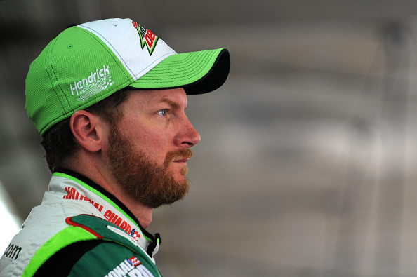 CHARLOTTE, NC - OCTOBER 09:  Dale Earnhardt Jr., driver of the #88 Diet Mountain Dew Chevrolet, looks on in the garage area during practice for the NASCAR Sprint Cup Series Bank of America 500 at Charlotte Motor Speedway on October 9, 2014 in Charlotte, North Carolina.  (Photo by Jonathan Moore/Getty Images)