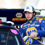 CHARLOTTE, NC - OCTOBER 09:  Chase Elliott, driver of the #9 NAPA Auto Parts Chevrolet, climbs into his car in the garage area during practice for the NASCAR Nationwide Series Drive For The Cure 300 presented by Blue Cross Blue Shield of North Carolina at Charlotte Motor Speedway on October 9, 2014 in Charlotte, North Carolina.  (Photo by Streeter Lecka/Getty Images)