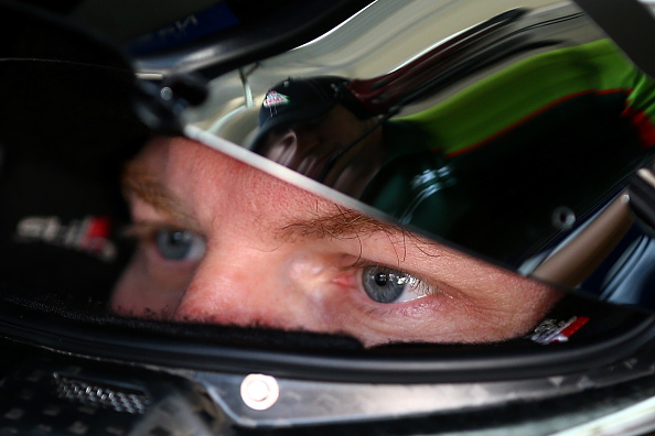 CHARLOTTE, NC - OCTOBER 10:  Dale Earnhardt Jr., driver of the #88 Diet Mountain Dew Chevrolet, sits in his car during practice for the NASCAR Sprint Cup Series Bank of America 500 at Charlotte Motor Speedway on October 10, 2014 in Charlotte, North Carolina.  (Photo by Streeter Lecka/Getty Images)