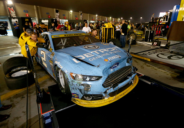 CHARLOTTE, NC - OCTOBER 11:  The #2 Detroit Genuine Parts Ford, driven by Brad Keselowski (not pictured), is pushed through the garage area after the NASCAR Sprint Cup Series Bank of America 500 at Charlotte Motor Speedway on October 11, 2014 in Charlotte, North Carolina.  (Photo by Streeter Lecka/Getty Images)