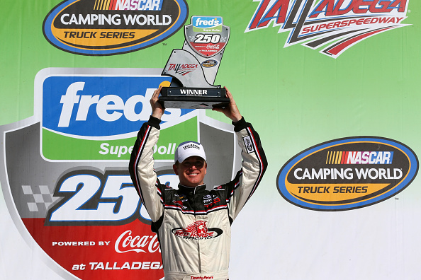 TALLADEGA, AL - OCTOBER 18:  Timothy Peters, driver of the #17 Red Horse Racing Toyota, poses in victory lane after winning the NASCAR Camping World Truck Series Fred's 250 Powered by Coca-Cola at Talladega Superspeedway on October 18, 2014 in Talladega, Alabama.  (Photo by Mike Ehrmann/Getty Images)