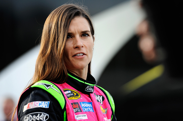 MARTINSVILLE, VA - OCTOBER 24:  Danica Patrick, driver of the #10 GoDaddy Breast Cancer Awareness Chevrolet, walks through the garage area prior to qualifying for the NASCAR Sprint Cup Series Goody's Headache Relief Shot 500 at Martinsville Speedway on October 24, 2014 in Martinsville, Virginia.  (Photo by Jared C. Tilton/Getty Images)