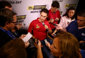 Driver Joey Logano speaks to the media during a press conference for the NASCAR Sprint Cup Series Contender 12 at NASCAR Hall of Fame on October 1, 2014 in Charlotte, North Carolina. (Getty Images)
