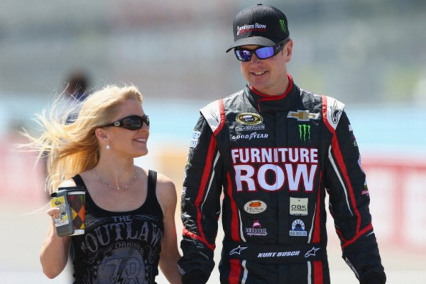 WATKINS GLEN, NY - AUGUST 10:  (R-L) Kurt Busch, driver of the #78 Furniture Row/Denver Mattress Chevrolet, walks on the grid with girlfriend Patricia Driscoll during qualifying for the NASCAR Sprint Cup Series Cheez-It 355 at The Glen at Watkins Glen International on August 10, 2013 in Watkins Glen, New York.  (Photo by Todd Warshaw/Getty Images)