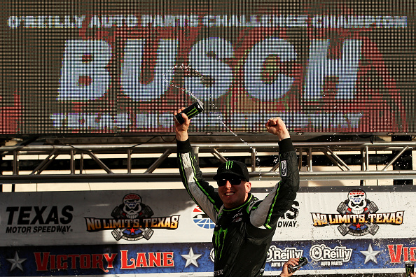 FORT WORTH, TX - NOVEMBER 01:  Kyle Busch, driver of the #54 Monster Energy Toyota, celebrates in Victory Lane after winning the NASCAR Nationwide Series O'Reilly Auto Parts Challenge at Texas Motor Speedway on November 1, 2014 in Fort Worth, Texas.  (Photo by Chris Graythen/Getty Images for Texas Motor Speedway)