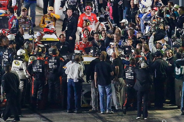 Drivers and crew members confront each other after the  NASCAR Sprint Cup Series AAA Texas 500 at Texas Motor Speedway on November 2, 2014 in Fort Worth, Texas.