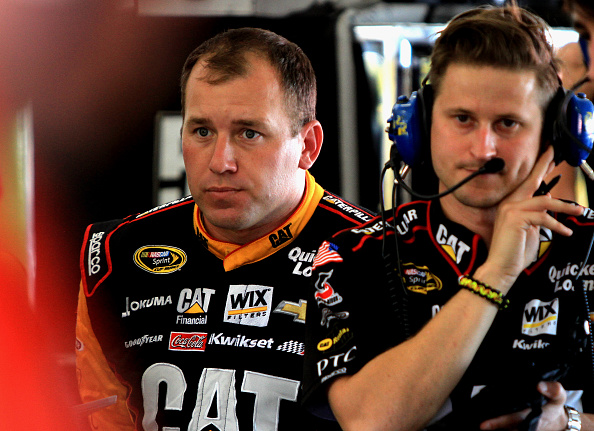 HOMESTEAD, FL - NOVEMBER 14:  Ryan Newman, driver of the #31 Caterpillar Chevrolet, stands in the garage area during practice for the NASCAR Sprint Cup Series Ford EcoBoost 400 at Homestead-Miami Speedway on November 14, 2014 in Homestead, Florida.  (Photo by Jerry Markland/Getty Images)