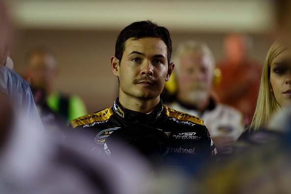 HOMESTEAD, FL - NOVEMBER 14:  Kyle Larson, driver of the #42 ParkerStore Chevrolet, stands on the grid during pre-race ceremonies for the NASCAR Camping World Truck Series Ford EcoBoost 200 at Homestead-Miami Speedway on November 14, 2014 in Homestead, Florida.  (Photo by Patrick Smith/Getty Images)