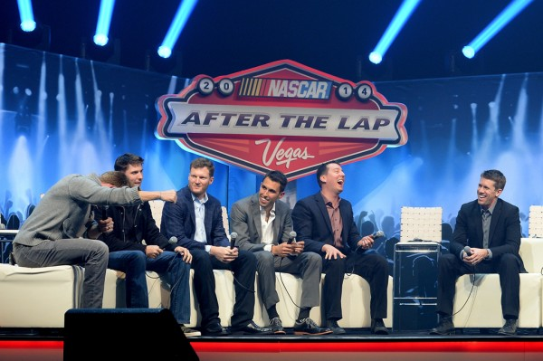LAS VEGAS, NV - DECEMBER 04: Host Marty Smith, Denny Hamlin, Dale Earnhardt Jr., Aric Almirola, Kyle Busch, and Carl Edwards react during the NASCAR Sprint Cup Series After the Lap show at The Pearl concert theater at the Palms Casino Resorton December 4, 2014 in Las Vegas, Nevada.  (Photo by Robert Laberge/NASCAR via Getty Images)