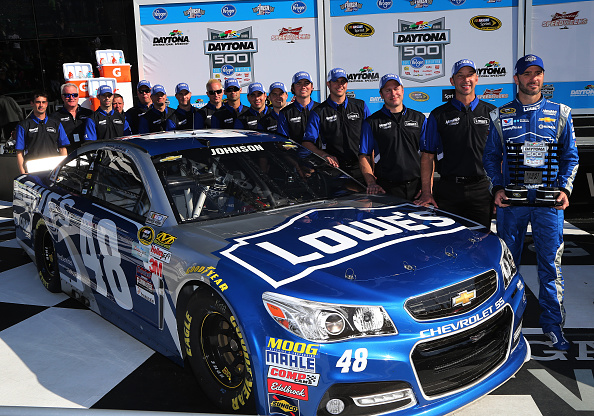 DAYTONA BEACH, FL - FEBRUARY 15:  Jimmie Johnson, driver of the #48 Lowe's Chevrolet, and his crew chief, Chad Knaus, pose with the Daytona 500 Front Row Award after qualifying for the front row for the 57th Annual Daytona 500 at Daytona International Speedway on February 15, 2015 in Daytona Beach, Florida.  (Photo by Jerry Markland/Getty Images)
