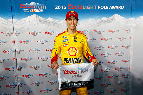 HAMPTON, GA - FEBRUARY 27:  Joey Logano, driver of the #22 Shell Pennzoil Ford, poses with the Pole Award after qualifying for the NASCAR Sprint Cup Series  Folds of Honor QuikTrip 500 at Atlanta Motor Speedway on February 27, 2015 in Hampton, Georgia.  (Photo by Kevin C. Cox/Getty Images)