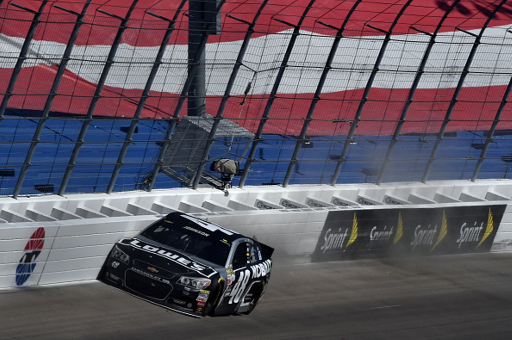Jimmie Johnson scrapes the wall Sunday at Las Vegas. (Getty Images)