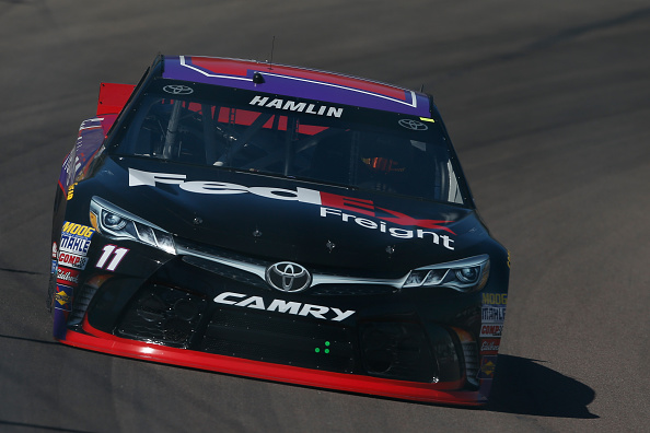 AVONDALE, AZ - MARCH 13:  Denny Hamlin, driver of the #11 FedEx Freight Toyota, drives during practice for the NASCAR Sprint Cup Series CampingWorld.com 500 at Phoenix International Raceway on March 13, 2015 in Avondale, Arizona.  (Photo by Christian Petersen/Getty Images)