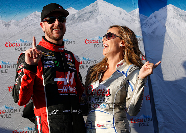 FONTANA, CA - MARCH 20:  Kurt Busch, driver of the #41 Haas Automation Chevrolet, poses for a photo with Miss Coors Light Rachel Rupert after winning the pole during qualifying for the NASCAR Sprint Cup Series Auto Club 400 at Auto Club Speedway on March 20, 2015 in Fontana, California.  (Photo by Doug Pensinger/Getty Images)