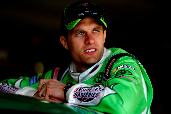 FONTANA, CA - MARCH 21:  David Ragan, driver of the #18 Interstate Batteries Toyota, stands in the garage area during practice for the NASCAR Sprint Cup Series Auto Club 400 at Auto Club Speedway on March 21, 2015 in Fontana, California.  (Photo by Jerry Markland/Getty Images)