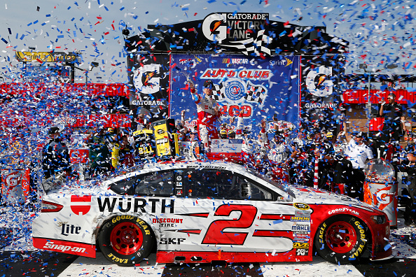 FONTANA, CA - MARCH 22:  Brad Keselowski, driver of the #2 Wurth Ford, celebrates in Victory Lane after winning the NASCAR Sprint Cup Series Auto Club 400 at Auto Club Speedway on March 22, 2015 in Fontana, California.  (Photo by Jerry Markland/Getty Images)