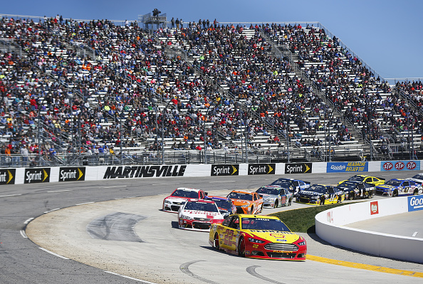 MARTINSVILLE, VA - MARCH 29:  Joey Logano, driver of the #22 Shell Pennzoil Ford, leads a pack of cars during the NASCAR Sprint Cup Series STP 500 at Martinsville Speedway on March 29, 2015 in Martinsville, Virginia.  (Photo by Matt Sullivan/Getty Images)