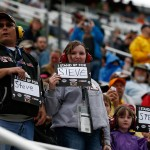 BRISTOL, TN - APRIL 19: Fans hold Stand Up 2 Cancer signs supporting Steve Byrnes during the NASCAR Sprint Cup Series Food City 500 at Bristol Motor Speedway on April 19, 2015 in Bristol, Tennessee.  (Photo by Jeff Zelevansky/Getty Images)
