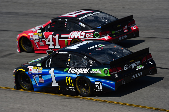 RICHMOND, VA - APRIL 26:  Jamie McMurray, driver of the #1 Energizer Chevrolet, and Kurt Busch, driver of the #41 Haas Automation Chevrolet, race during the NASCAR Sprint Cup Series Toyota Owners 400 at Richmond International Raceway on April 26, 2015 in Richmond, Virginia.  (Photo by Jared C. Tilton/Getty Images)