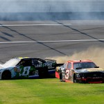 TALLADEGA, AL - MAY 02:  Blake Koch, driver of the #8 LeafFilter Gutter Protection Toyota, and Ty Dillon, driver of the #3 Bass Pro Shops Chevrolet, wreck during the NASCAR XFINITY Series Winn Dixie 300 at Talladega Superspeedway on May 2, 2015 in Talladega, Alabama.  (Photo by Brian Lawdermilk/Getty Images)