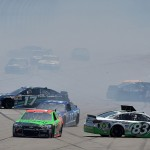 TALLADEGA, AL - MAY 03:  Matt DiBenedetto, driver of the #83 Dustless Blasting Toyota, Ricky Stenhouse Jr., driver of the #17 Fifth Third Bank Ford, and Greg Biffle, driver of the #16 Ortho Ford, are involved in an incident during the NASCAR Sprint Cup Series GEICO 500 at Talladega Superspeedway on May 3, 2015 in Talladega, Alabama.  (Photo by Drew Hallowell/Getty Images)