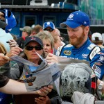KANSAS CITY, KS - MAY 08:  Dale Earnhardt Jr., driver of the #88 Nationwide Chevrolet, signs autographs during practice for the NASCAR Sprint Cup Series SpongeBob SquarePants 400 at Kansas Speedway on May 8, 2015 in Kansas City, Kansas.  (Photo by Jerry Markland/Getty Images)