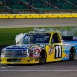 KANSAS CITY, KS - MAY 08:  Ben Kennedy, driver of the #11 Local Motors/SpongeBob SquarePants Toyota, drives toward the pits as his truck overheats during the NASCAR Camping World Truck Series Toyota Tundra 250 at Kansas Speedway on May 8, 2015 in Kansas City, Kansas.  (Photo by Jerry Markland/Getty Images)