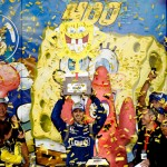 KANSAS CITY, KS - MAY 09:  Jimmie Johnson, driver of the #48 Lowe's Chevrolet, celebrates with the trophy in Victory Lane after winning the NASCAR Sprint Cup Series SpongeBob SquarePants 400 at Kansas Speedway on May 9, 2015 in Kansas City, Kansas.  (Photo by Jonathan Ferrey/Getty Images)