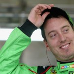 CHARLOTTE, NC - MAY 15:  Kyle Busch, driver of the #18 M&M's Red Nose Day Toyota, stands in the garage area during practice for the NASCAR Sprint Cup Series All-Star Race at Charlotte Motor Speedway on May 15, 2015 in Charlotte, North Carolina.  (Photo by Brian Lawdermilk/Getty Images)